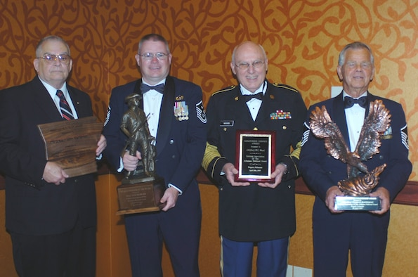 (From left) Retired Army Guard Warrant Officer John Heffernan, Master Sgt. Bob Oldham, retired Army Guard 1st Sgt. W.C. Wood and retired Air Guard Master Sgt. Charlie Hagerman with their Enlisted Association of the Arkansas National Guard awards. (U.S. Air Force photo by Maj. Keith Moore)