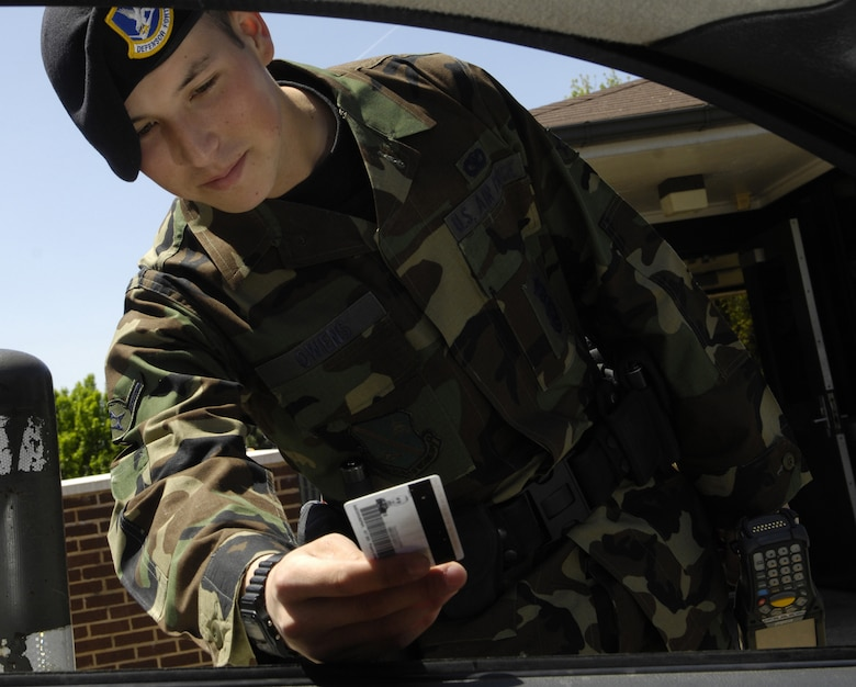 Airman Brandon L. Owens, 11th Security Forces Squadron, checks an ID card at Bolling's south gate May 7. A representative from the National Crime Prevention Council will be at the technology center May 14 at 1 p.m. to discuss tips on staying safe on the Internet and avoiding identity theft. The 11th Security Forces Squadron hosts this event in honor of police week, May 14 through 18. For more information, call Staff Sgt. Jana McClintock at (202) 767-8949. (U.S. Air Force photo by Senior Airman Dan DeCook)