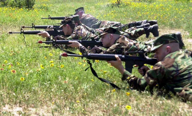 Cadets from Air Force Reserve Officer Training Corps Detachment 847 line up and fire M-16 rifles loaded with blank ammunition during the air base defense section of a field training exercise April 28 at Goodfellow Air Force Base, Texas. Instructors from the 17th Security Forces Squadron assisted the cadets with basic firearm safety and cleaning procedures. (U.S. Air Force photo by Airman 1st Class Stephen Musal)