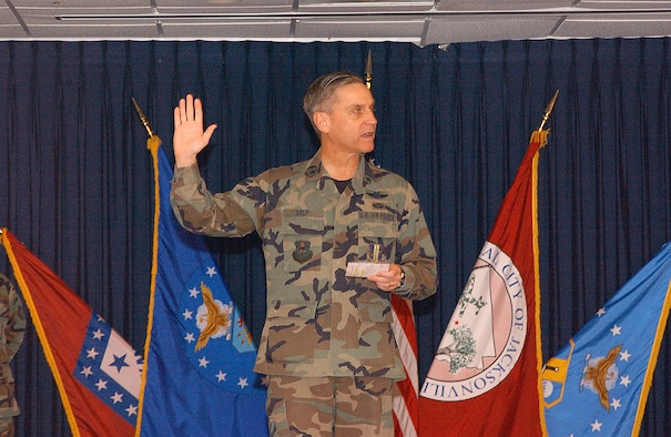 Brig. Gen. Kip Self, 314th Airlift Wing commander, administers the oath of enlistment to a group of honorary commanders at Little Rock Air Force Base.