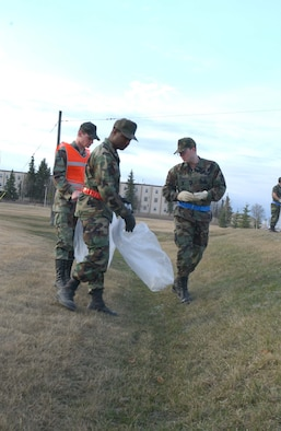 EIELSON AIR FORCE BASE, Alaska -- Airmen of the 354 Communications Squadron, participate in the Annual FOD walk on May 04. After a long winter, break up arrives leaving debree that has been barried under the snow for months and Airmen around the base do their part by picking up trash to keep the base clean. (U.S. Air Force photo by Airman 1st Class Christopher Griffin)