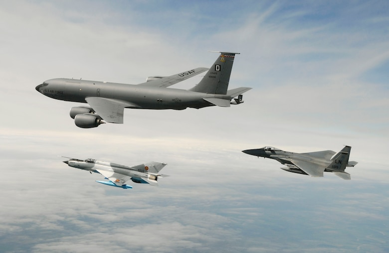 """MIHAIL KOGALNICEANU, ROMANIA – 1st Lt. Andrew Weidner, an F-15 """"Eagle"""" pilot assigned to the 493rd Fighter Squadron at RAF Lakenheath, and a Romanian MiG-21 fly along side a KC-135 """"Stratotanker"""" from  RAF Mildenhall's 351st Air Refueling Squadron during a training mission over Eastern Romania Wednesday.  More than 200 U.S. Air Forces in Europe Airmen, mostly from RAF Lakenheath and Mildenhall, are in Romania participating in Exercise Sniper Lance 2007.  """"Sniper Lancer"""" is being staged out of Mihail Kogalniceanu Air Base near the Eastern Coast of Romania.  (Photo by Ben Bloker, European Stars & Stripes)"""