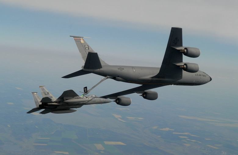 """MIHAIL KOGALNICEANU, ROMANIA – 1st Lt. Andrew Weidner, an F-15 """"Eagle"""" pilot assigned to the 493rd Fighter Squadron at RAF Lakenheath, receives fuel in-flight from an RAF Mildenhall KC-135 """"Stratotanker"""" assigned to the 351st Air Refueling Squadron during a training mission over Eastern Romania Wednesday.  More than 200 U.S. Air Forces in Europe Airmen, mostly from RAF Lakenheath and Mildenhall, are in Romania participating in Exercise Sniper Lance 2007.  """"Sniper Lancer"""" is being staged out of Mihail Kogalniceanu Air Base near the Eastern Coast of Romania.  (Photo by Ben Bloker, European Stars & Stripes)"""