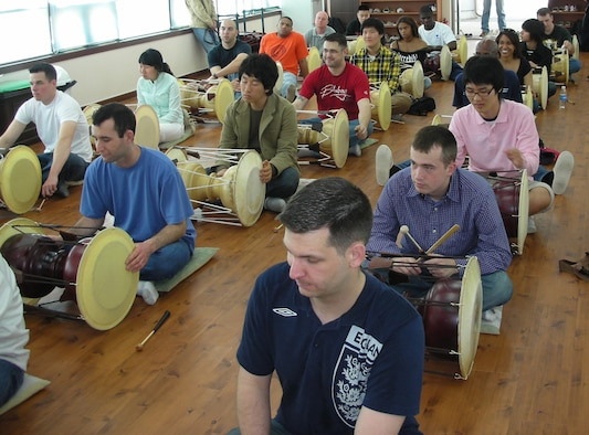 GYEONGGI, Republic of Korea --  Participants of the 8th Army's Head Start Program practice playing traditional drums at the Gyeonggi Traditional Music Center recently. (U.S. Air Force photo)
