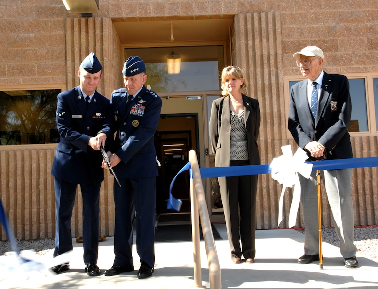 Lt. Gen. Norman Seip; commander 12th Air Force and Air Forces Southern; along with Airmen Kyle Bridgford,12th Air Forces most junior Airmen, unveils the new Gen. James H. Doolittle Combined Air and Space Operations Center as Doolittle Raider, Maj. Gen. (Retired) David Jones and Jonna Hoppes, General James Doolittle's granddaughter, looks on during a ribbon cutting ceremony May 9 at Davis-Monthan Air Force Base. The building was named in honor of General James H. Doolittle; 12th Air Force's first commander and the Doolittle Raiders for their heroic actions during World War II.