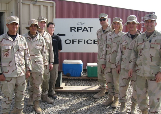 "CONTINGENCY OPERATING BASE SPEICHER, Iraq -- Chap. (Capt.) David DePinho, (front-right,) a chaplain with the 332nd Air Expeditionary Wing, was inspired by the motivation shown by the men and women of the 732nd Expeditionary Logistics Readiness Squadron, Det 1 Retrograde Property Action Team or ""RPAT"" serving in ""In-Lieu-Of"", (ILO) positions for the Army as they process cargo and vehicles for movement by air instead of convoys, saving countless lives in the process. (Courtesy photo)"