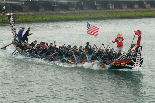 "The Kadena ""Shoguns"" dragon boat men's team tries to row their way ahead of the Navy and the Japan Ground Self-Defense Force teams in the 33rd Annual Naha Dragon Boat races at Naha Port May 5.  Two teams from Kadena Air Base, Japan -- a men's and women's team -- were part of more than 50 teams, including eight military teams from U.S. bases on Okinawa, that took part in the annual competition. Among the U.S. military teams, the Air Force finished second at 5:00.22 minutes in the men's division.  (U.S. Air Force/Airman 1st Class Kasey Zickmund)"