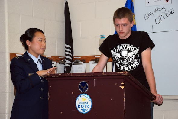 Taylor Lewis, a Junior Reserve Officer Training Cadet, shares his thoughts in front of his class during a debate for a class exercise being taught by Capt. Nora Cho, 22nd Air Refueling Wing Judge Advocate May 1 at Derby High School. On Law Day, Captain Cho teaches the students about the rights and privileges that youths have as U.S. citizens. (U.S. Air Force photo by Airman 1st Class Jessica Lockoski, 22nd ARW Public Affairs)