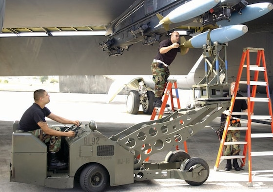 Airmen from the 36th Munitions Squadron load weapons on a B-52.