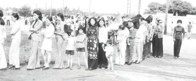 "New Life refugees waiting in line at Andersen's ""Tin City"" barracks. (Photo courtesy of the 36th Wing History Office)"