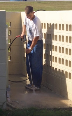 Airman 1st Class John Loker, 36th Logistics Readiness Squadron, volunteers after class to power wash the FTAC building. (Courtesy photo)