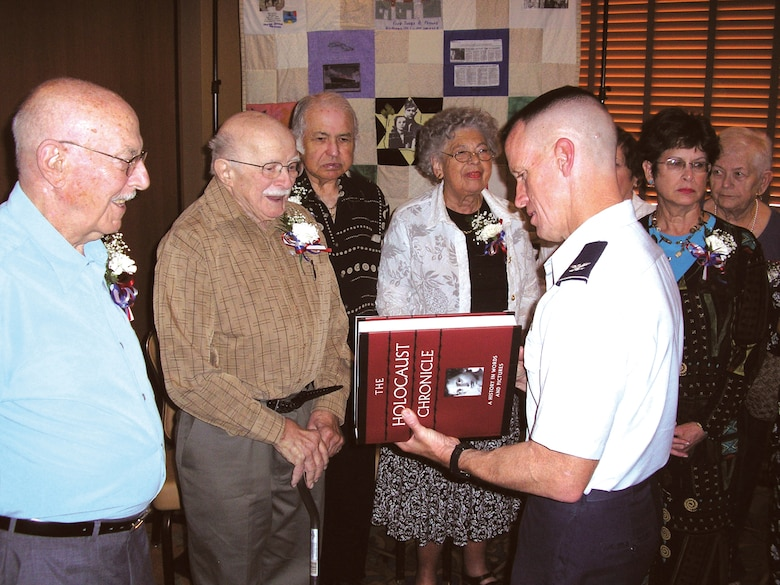 Desert Dove Chapel sponsored a Holocaust Remembrance Ceremony honoring the survivors. D-M Airmen attended and escorted survivors honoring them at a luncheon at the Davis-Monthan Mirage Officers club. (DLN photo/Diane M. Kephart)