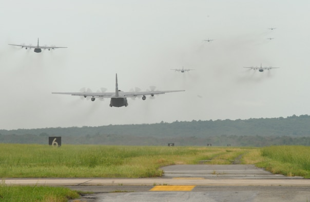 Little Rock Air Force Base C-130's fly in formation during an exercise May 11, 2007. Fourteen C-130's participated as part of the Air Force Weapons School syllabus for C-130 and C-17 Weapons Instructor Courses. (U.S. Air Force photo by Airman First Class Christine A Clark)