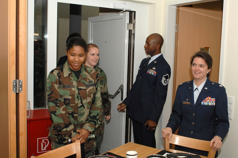 Lt. Col. Kathryn Kolbe (right) tours a new dormitory with Airmen May 10 at Spangdahlem Air Base, Germany. Colonel Kolbe is commander of the 52nd Civil Engineer Squadron. (U.S. Air Force photo)
