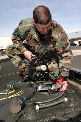MCCHORD AIR FORCE BASE, Wash. -- Staff Sgt. Joseph Pinkham, 62nd Logistics Readiness Squadron, checks the seal on a manhole on the catwalk of an R-11 fuel truck servicing vehicle. (U.S. Air Force photo/Abner Guzman)