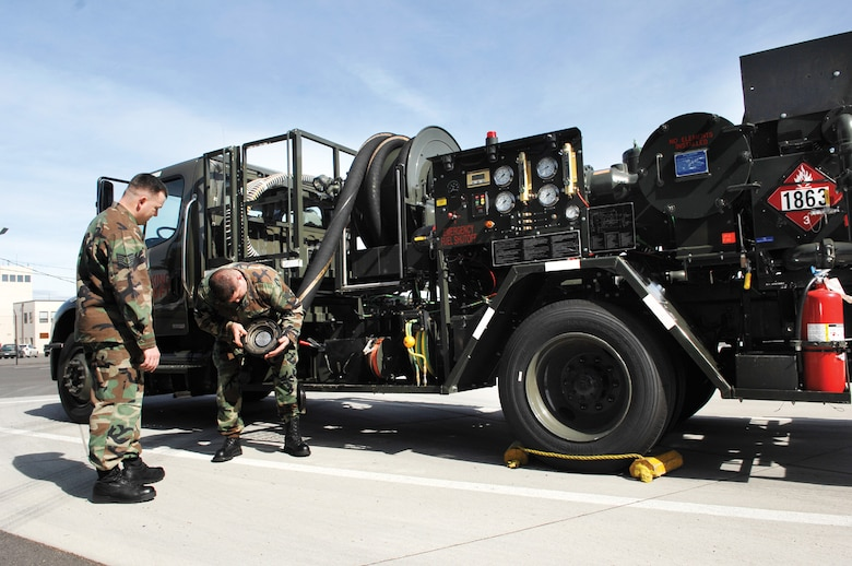 MCCHORD AIR FORCE BASE, Wash. -- Tech. Sgt. Greg Carrow, left, and Staff Sgt. Joseph Pinkham, both from the 62nd Logistics Readiness Squadron, carefully examine a hydrant coupler attached to an R-11 fuel truck servicing vehicle during a routine spot check. (U.S. Air Force photo/Abner Guzman)