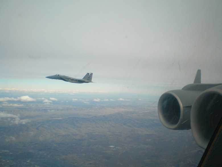MCCHORD AIR FORCE BASE, Wash. -- An F-15 Eagle from Klamath Falls, Ore., flies alongside a McChord C-17 Globemaster III as part of a Simulated Penetration Air Defense Exercise scenario over central Washington in February. The C-17 is playing the role of a hijacked airliner. (U.S. Air Force photo)