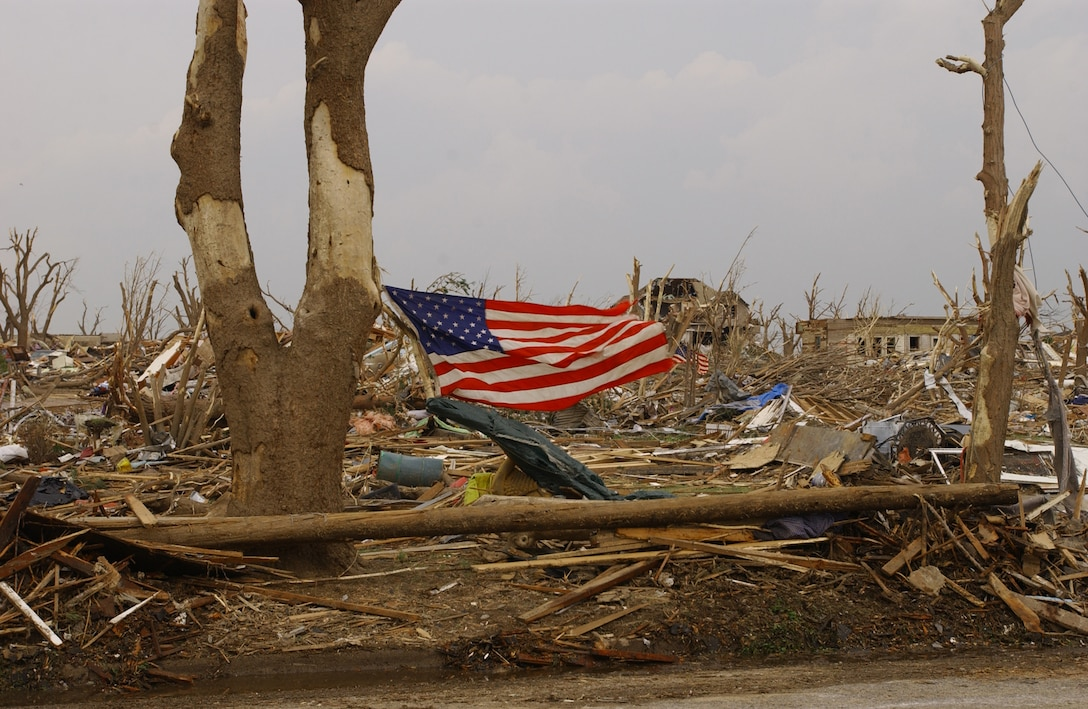 An American flag flies in Greensburg, Kan., after an F5 tornado hit the town May 4. Around 500 Army and Air National Guardmembers are in Greensburg removing debris, providing security, generating power, preparing food and performing other disaster relief functions. (U.S. Air Force photo)