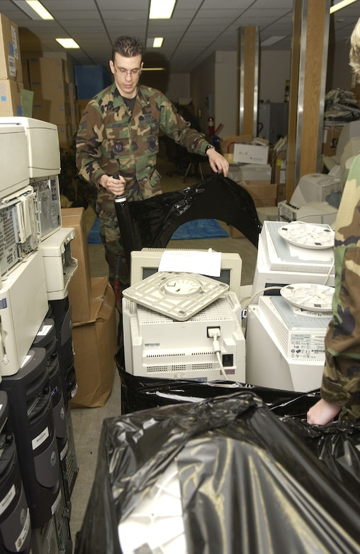 SPANGDAHLEM AIR BASE, GERMANY -- Senior Airman Joshua Spears, 52nd Communications Squadron computer systems management technician, prepares to wrap a pallet of monitors to ensure the items are stable enough for transport to the TMO/DRMO warehouse. Photo by Senior Airman Josie Kemp
