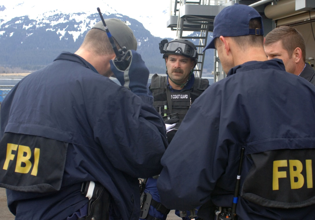 SEWARD, Alaska (May 11, 2007) – A member of U.S. Coast Guard Maritime Safety & Security Team, Anchorage (MSST 91111) speaks with a FBI special agent after completing a search of USNS Henry J. Kaiser (T-AO 187) as part of Alaska Shield/Northern Edge 07 (AKS/NE 07). AKS/NE 07 is a State of Alaska/US NORTHCOM sponsored homeland defense/defense support of civil authorities exercise; part of the national-level Ardent Sentry/Northern Edge 07.  It's an opportunity to practice responding to homeland defense/disaster events with the federal, state, local & private-sector team. U.S. Navy photo by Mass Communication Specialist 1st Class Daniel N. Woods