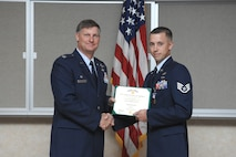 Col. Michael Bartley, commander, 99th Air Base Wing, awards Staff Sgt. Scott B. White (right) with the U.S Army Soldier's Medal on May 10, 2007, at Nellis AFB, Nevada.  Sergeant White is an explosive ordnance disposal technician assigned to the 99th Civil Engineering Squadron's EOD Flight. (U.S Air Force Photo by: Airman 1st Class Nadine Barclay)