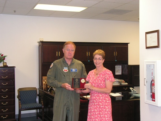 General Robert Keys, ACC Commander, presents Ms. Susan Bibus, 67th Network Warfare Wing with the 2006 ACC Civilian Personnel Specialist of the Year Award during his visit to the wing on May 11.