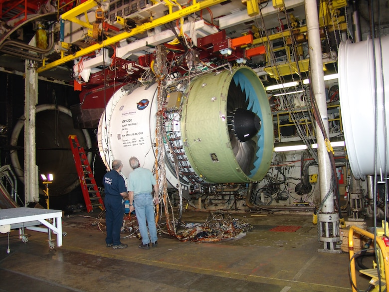 A Pratt & Whitney engine technical specialist and an AEDC technician inspect a GP7200 engine, one of the power plants for the Airbus Industries A380, in April 2004 prior to testing in AEDC's Aeropropulsion Systems Test Facility Test Cell. The GP7200 is manufactured under the GE-Pratt & Whitney Engine Alliance.