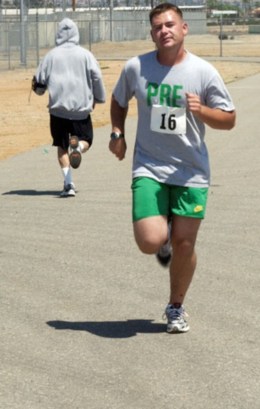 Chris Lowe took first place in the five kilometer run at March Air Reserve Base with a time of 20 minutes, 41 seconds. He was followed by James Moat running a 20:49. (U.S. Air Force photos by Staff Sgt. Amy Abbott)