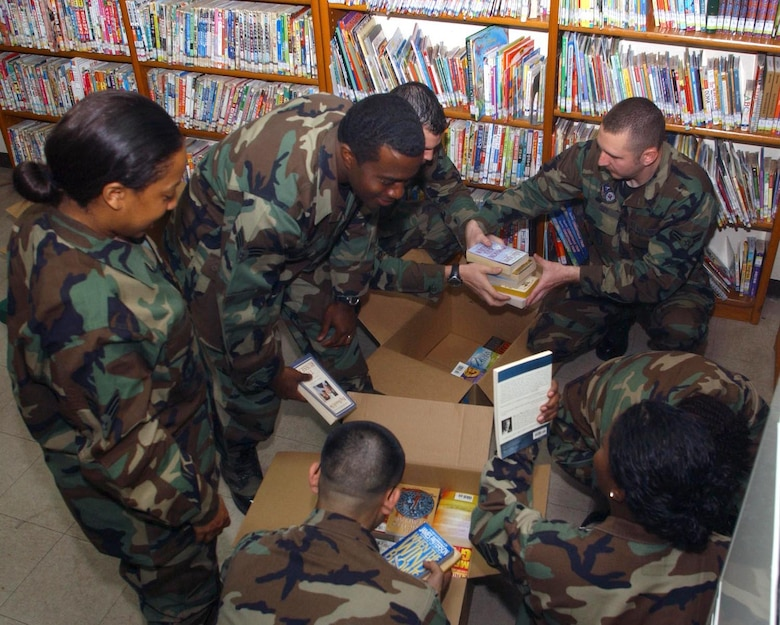 "GUNSAN CITY, Republic of Korea  May 11, 2007 -- Airmen Committed to Excellence members unpack English books to be shelved in the English reading section of the Gunsan City library May 11. Known as the ""Wolf Pack Paperback"" English book drive, the ACE organization raised more than 475 books. (U.S. Air Force photo/Senior Airman Steven Doty)"