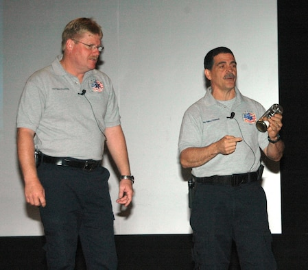 Florida firefighters Ronny Garcia (pictured right) and Kevin Reed give a SAFE brief to Ellsworth Airmen April 27 at the base theater.  SAFE features members of the medical and law enforcement  community who share their no-hold barred and grittily honest experiences with audiences around the world. (U.S. Air Force photo/Tech. Sgt. Todd Wivell)