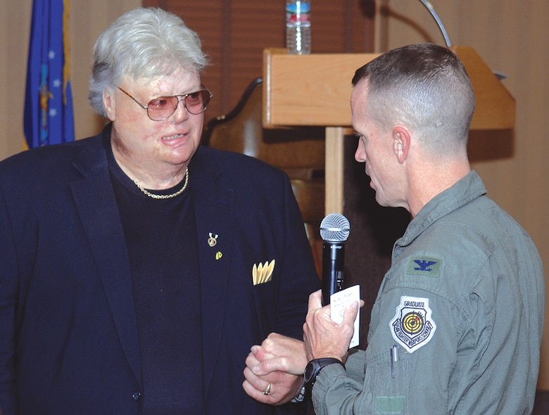 355th Fighter Wing Commander Col. Kent Laughbaum awards Dr. Dave Roever a commander's coin in appreciation for his sacrifice, dedication, loyalty and continued motivational messages to troops around the world.