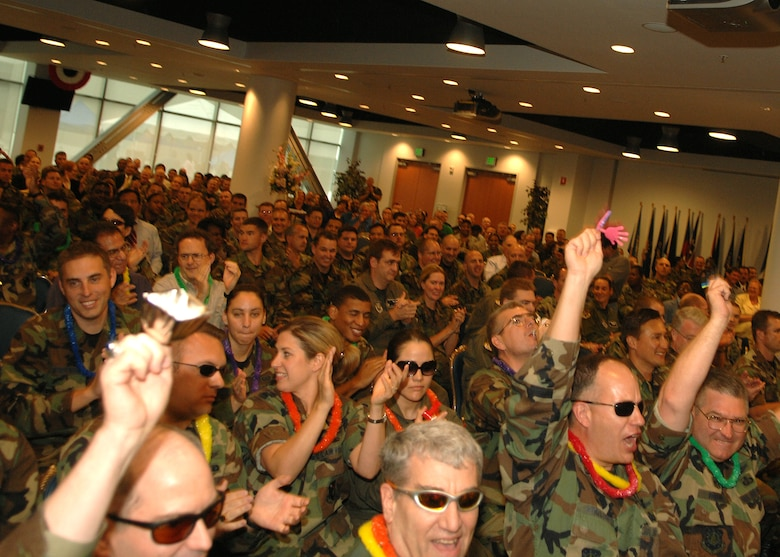 Personnel from the Military Satellite Communications Systems Wing get rowdy at the Los Angeles Air Force Base ORI out brief on May 15. The wing was one of four wings and groups to be inspected under the compliance portion of the ORI.