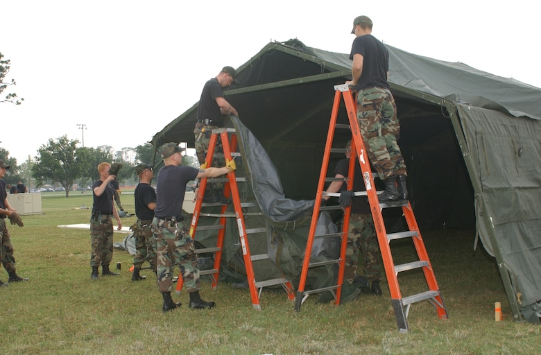 Members of the 81st Civil Engineer Squadron and 81st Services Division assemble 10 Temper tents, May 15 for next week's exercise. (U.S. Air Force Photo by Kemberly Groue)