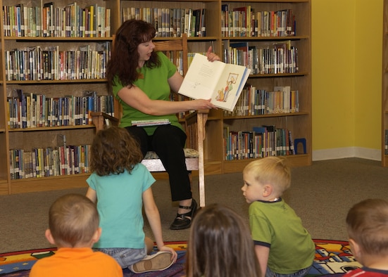 Lisa Martin, library technician, reads to Bolling children during story time at the base library May 15. The library holds story time Tuesdays at 10 a.m and Thursdays at 2 pm. Located in Building 4439 on Tinker Street, the library is open Monday through Friday from 10 a.m. to 8 p.m. and Saturday from noon to 5 p.m. It is closed Sundays and federal holidays. For more information, call (202) 767-5578. (U.S. Air Force photo by Airman 1st Class Sean Adams)