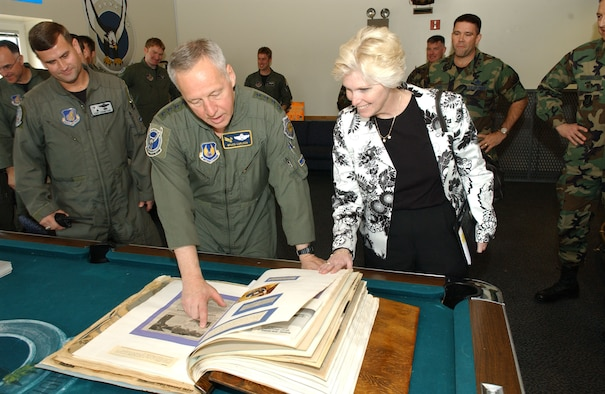 EIELSON AIR FORCE BASE, Alaska --Gen. Bruce Carlson, Air Force Material Command commander, Wright-Patterson AFB, Ohio, looks through a scrap book with Vicki Carlson and members of the 355th Fighter Squadron on May 14th. Gen. Carlson was at one time a member of the 355th Fighter Squadron and as he flipped through the scrap book told stories about people and events he had recognized, Eielson is one of many stops the General will make through the Pacific Air Forces.  (U.S. Air Force photo by Airman 1st Class Christopher Griffin)