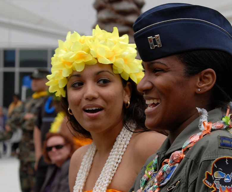 A member of the hula dance team chats with a military member during the Asian American Hertiage Month picnic held at the Schriever Space Complex, May 16.