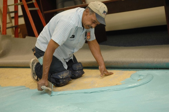 Shaw Air Force Base, S.C. -- John Council, contracted carpet installer, spreads glue as part of the carpet installation in the 20th Fighter Wing Command Post May 15. The new carpet is part of a $1.1 million command post renovation. (U.S. Air Force photo/Staff Sgt. Josef Cole)