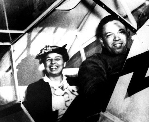 "First Lady Eleanor Roosevelt supported the Civilian Pilot Training Program and the War Training Service. She is pictured here in a Piper J-3 Cub trainer with C. Alfred ""Chief"" Anderson, a pioneer black aviator and respected instructor at Tuskegee Institute. (U.S. Air Force photo)"