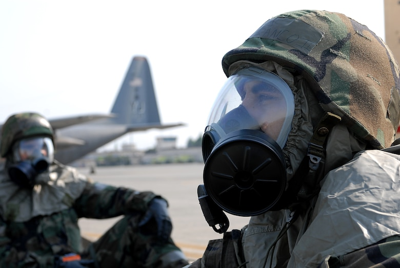 Staff Sargeant John Franco II, of the 374th Aircraft Maintenance Squadron, waits for the all clear from the simulated attack during Beverly Morning 07-05. Beverly Morning is an exercise that tests and trains Airmen in war time scenarios.(U.S. Air Force photo by Airmen 1st Class John M. Albea VIRIN )