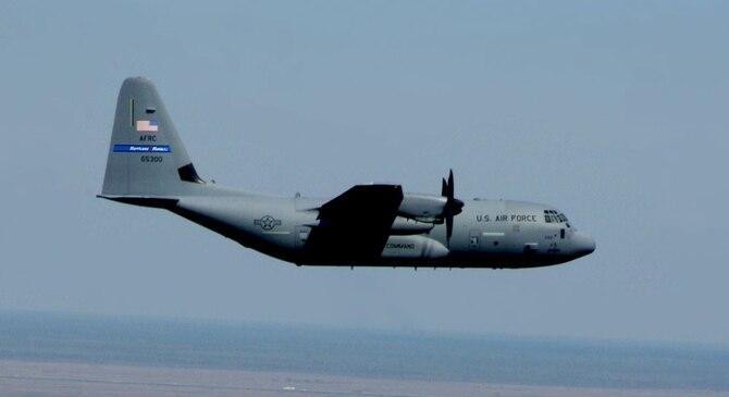 "WC-130J ""Hurricane Hunter"" Aircraft flies over coastline"