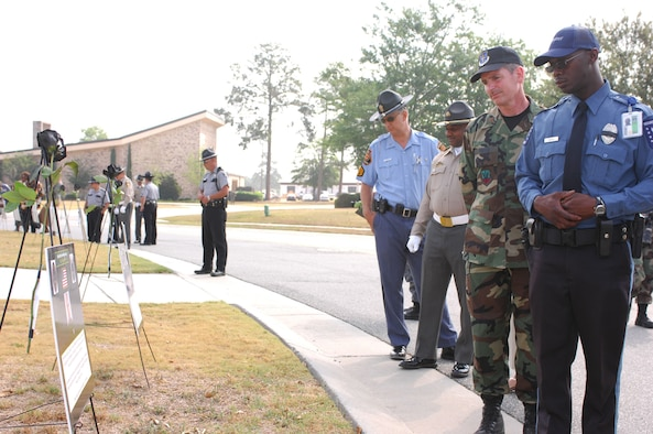 Moody security forces Airmen join policemen from Lowndes County, Valdosta, and the Georgia State Patrol to pay tribute to officers who were killed in action during  Police Week Memorial Ceremony May 15. Moody's Police Week featured several events, including the memorial and a golf tournament, to recognize the efforts of policemen. (U.S. Air Force photo by Senior Airman Angelita M. Lawrence)