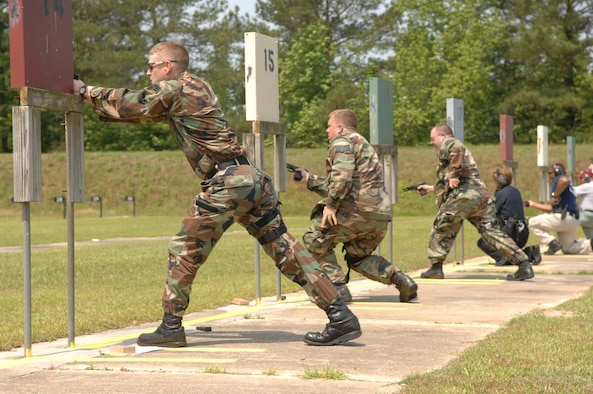 SUMTER, S.C.-- Senior Airman Tommy Dailey, Staff Sgt. Edward Lincoln and Staff Sgt. Richard Dorsey, 20th Security Forces Squadron and local law enforcement members participate in friendly competition at the Sumter Police Department firing range May 16. During the week, on and off-base events included city and county police and 20th Security Forces Squadron members. The theme for each of the events was remembering those who made the ultimate sacrifice. (U.S. Air Force photo/Airman 1st Class Matthew Davis)