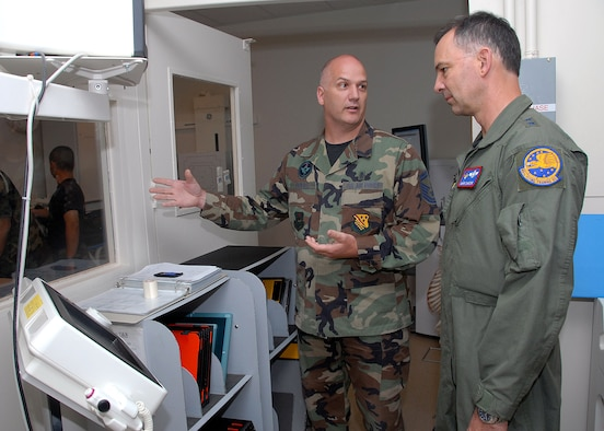 Senior Master Sgt. David Pickrel, 382nd Training Squadron, explains the diagnostic imaging course to Maj. Gen. Mark Zamzow, Air Education and Training Command air, space and information operations director, during the general's visit May 14. (U.S. Air Force photo/Mike Litteken)