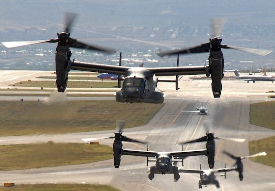 Air Force CV-22 Ospreys take off from a Kirtland Air Force Base, N.M. May 1 for a training mission.  The Osprey is a tiltrotor aircraft that combines vertical takeoff, hover and landing qualities of a helicopter with the normal flight characteristics of a turboprop aircraft.  (U.S. Air Force photo/Staff Sgt. Markus Maier)