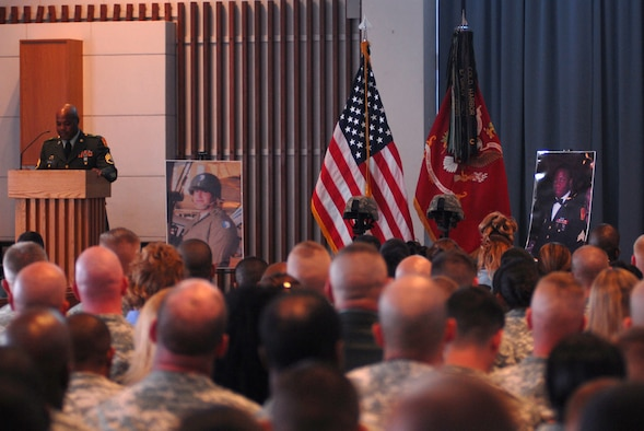 Staff Sgt. Malow Rooks speaks at a memorial service for Staff Sgt. Kenneth Thomas and Sgt. Richard Smith, all members of 1-1 Air Defense Artillery Battalion, May 17. Staff Sgt. Thomas and Sgt. Smith were killed in a car accident May 12 on Okinawa, Japan.