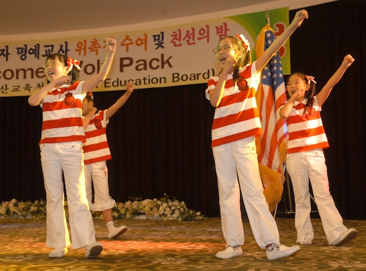 "GUNSAN CITY, Republic of Korea  May 17, 2007 -- Students from Jikok elementary school here sing for 8th Fighter Wing ""Wolf Pack"" Airmen and honored guests May 16 during the 2007 English volunteer recognition dinner. 55 Airmen at Kunsan Air Base were recognized by the local education board for their dedication in helping teach English to elementary and middle school students. (U.S. Air Force photo/Senior Airman Stephen Collier)"