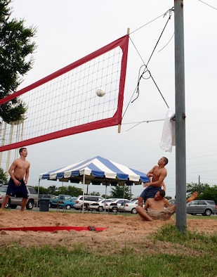 Members of the 82nd Civil Engineer Squadron participate in the volleyball competition during the Armed Forces Day picnic May 18. (U.S. Air Force photo/Staff Sgt. Tonnette Thompson)