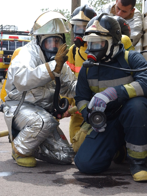 (Left), Mr. Herbert Gaekel, a Honduran fire inspector,  gives instructions to a Honduran firefighter prior to entering the burn building during a training exercisea at Soto Cano Air Base May 19, 2007. U.S. Air Force photo by Senior Airman Shaun Emery