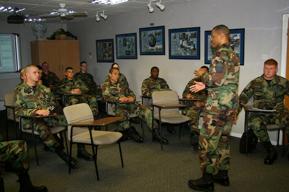 Master Sgt. Rodney Whitaker, standing, 100th Air Refueling Wing Ground Safety manager, talks to First Term Airmen's Center troops May 16 about his experience of being hit by a drunk driver. Sergeant Whitaker was speaking as part of the DUI panel, made up of 11 troops who have had a DUI affect their lives, whether they got a DUI, or were hit or injured by a drunk driver, or know someone who got a DUI. Those on the panel range from a senior master sergeant, who once had to identify the body of one of his troops who had been drink-driving, to Airmen who have received a DUI. Being on the panel is entirely voluntary, and gives those on it a chance to speak freely to new, young Airmen and share their stories. (U.S. Air Force photo by Karen Abeyasekere)