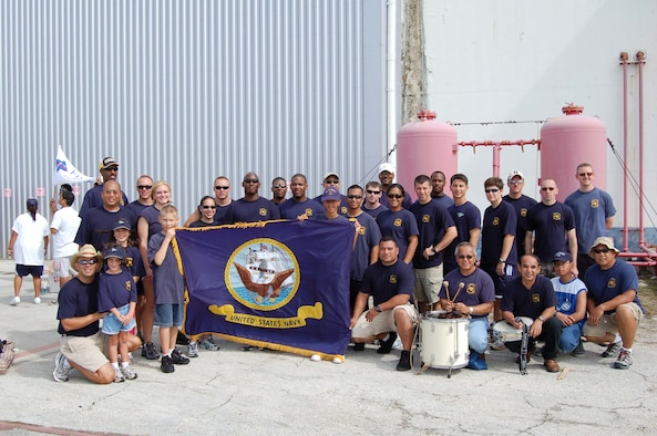 Sailors from Helicopter Sea Combat Squadron-Two Five pose after placing third in the Continental Airlines Plane Pull.